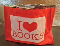 "Red bag with a design saying ""I (heart symbol) books"""